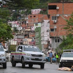 In this file photo taken on July 09, 2021, Members of the Directorate of Strategic Intelligence (DIE) patrol one of the main streets of the Cota 905 barrio after three days of clashes with alleged members of a criminal gang in Caracas on July 9, 2021.