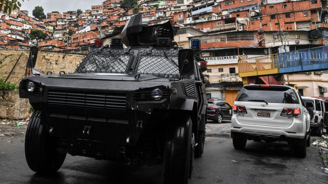 In this photo taken on July 09, 2021, a VN-4 armoured vehicle of a special unit of the national police drives along one of the main streets of the Cota 905 neighbourhood after three days of clashes with alleged members of a criminal gang, in Caracas on July 9, 2021.