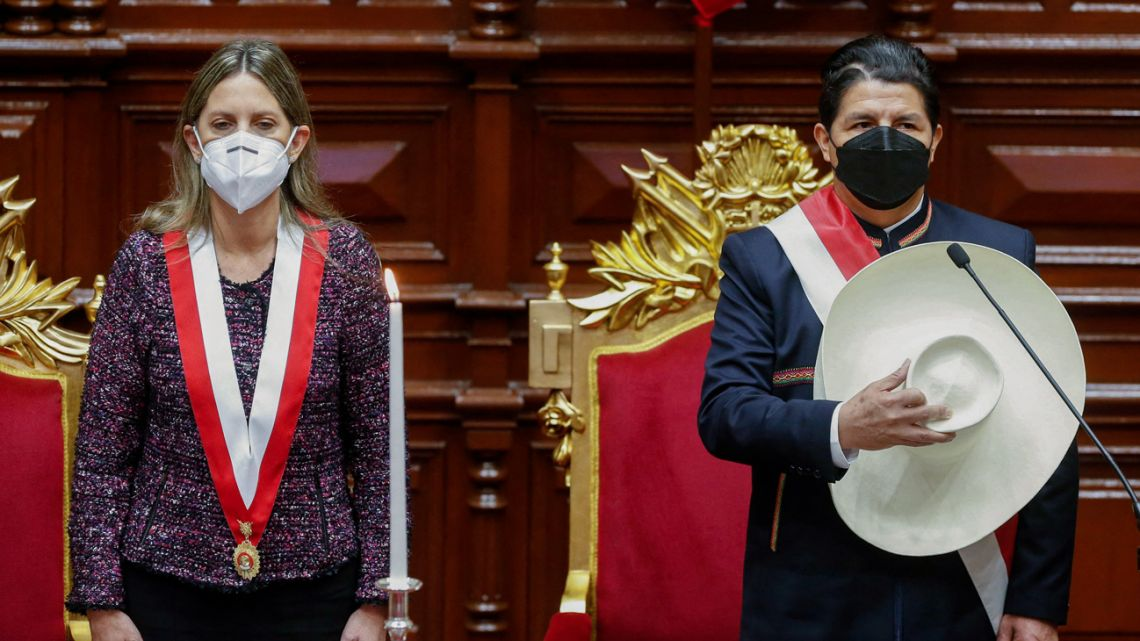 Peru's new President Pedro Castillo is sworn-in by Congress President María del Carmen Alva during his inauguration ceremony at the National Congress in Lima, on July 28, 2021.