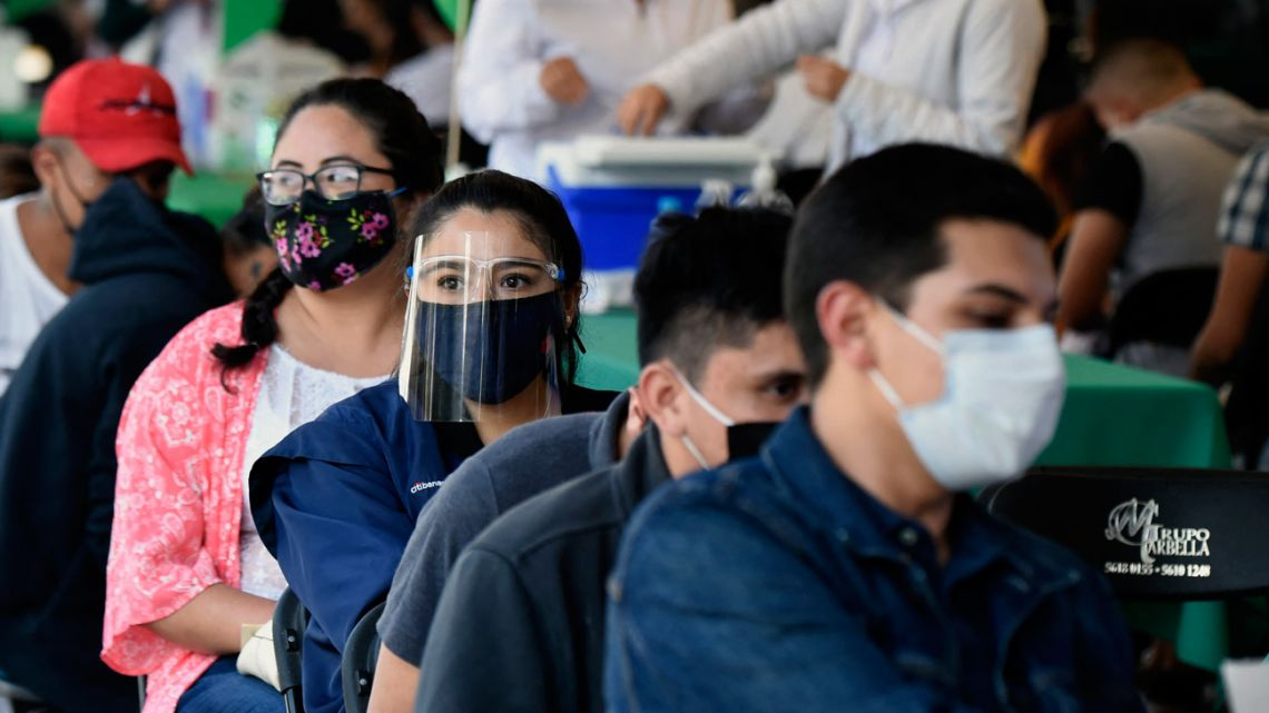 People wait to receive their first dose of the Sputnik-V vaccine against Covid-19 in Mexico City, on July 27, 2021.