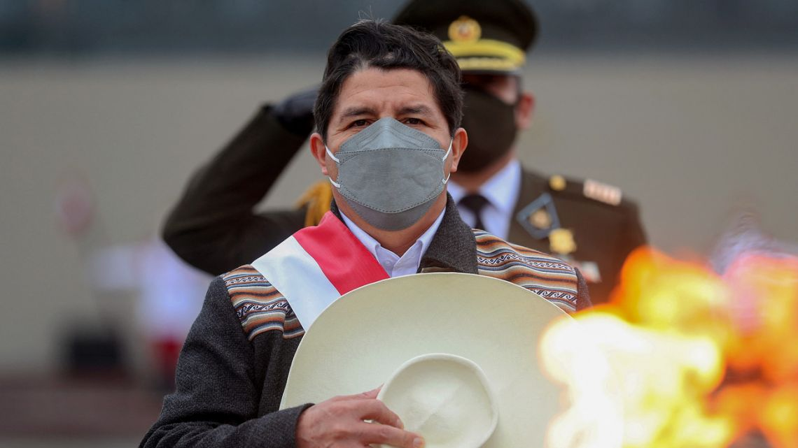 Handout picture released by the Peruvian Presidency of Peruvian President Pedro Castillo attending a military parade commemorating the country's Independence Day, in Lima on July 30, 2021.