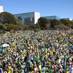 Manifestantes participan en una concentración en apoyo al presidente brasileño Jair Bolsonaro y pidiendo un modelo de voto impreso en la Explanada de los Ministerios en Brasilia, Brasil.   Foto:Evaristo Sa / AFP