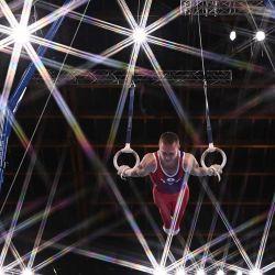 El ruso Denis Abliazin compite en la final de anillas de gimnasia artística masculina de los Juegos Olímpicos de Tokio 2020 en el Centro de Gimnasia Ariake en Tokio.   Foto:Jeff Pachoud / AFP