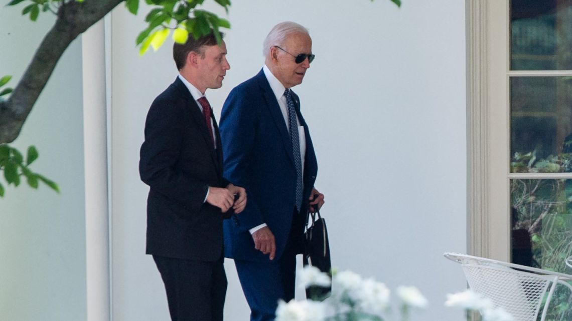 US President Joe Biden walks with National Security Advisor Jake Sullivan (left) to the Oval Office of the White House in Washington, DC, July 27, 2021, after travelling to the Office of the Director of National Intelligence in Virginia.