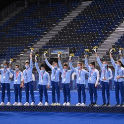 Las Leonas, Argentina's silver medallists, pose on the podium during the medal ceremony of the Tokyo 2020 Olympic Games women's field hockey competition, at the Oi Hockey Stadium, on August 6, 2021.