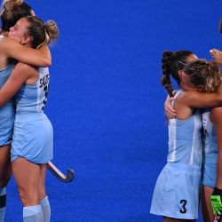 (Left to right): Argentina's María Noel Barrionuevo and Victoria Sauze Valdéz, and Agustina Gorzelany and Delfina Merino embrace after losing to Netherlands 3-1 in the women's gold medal match of the Tokyo 2020 Olympic Games field hockey competition, at the Oi Hockey Stadium in Tokyo, on August 6, 2021.
