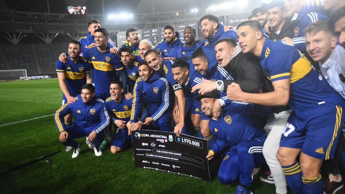 Boca Juniors' players celebrate after defeating River on penalties.