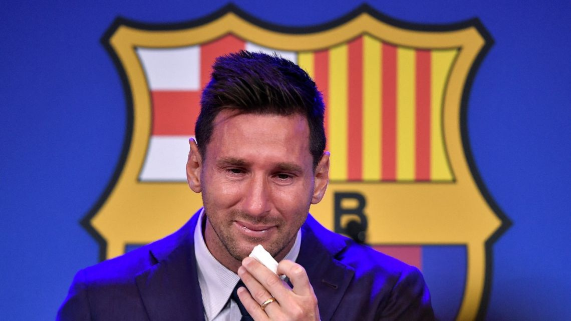 Lionel Messi cries during a press conference at the Camp Nou stadium in Barcelona, as he confirms his departure from the club after 20 years, on August 8, 2021.