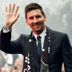 Paris Saint-Germain's forward Lionel Messi salutes supporters gathered outside the Parc des Princes stadium after his first official press conference as PSG player in Paris on August 11, 2021.