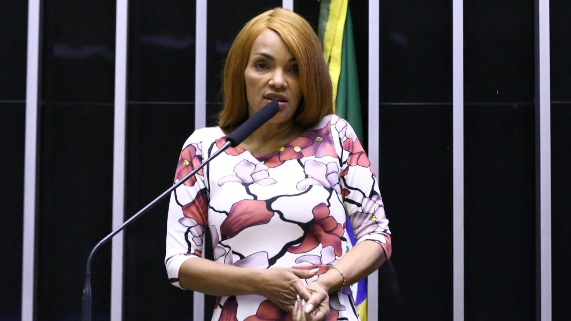 Handout picture released by the Brazilian Chamber of Deputies showing Brazilian Deputy Flordelis dos Santos de Souza speaking during a session in which her removal was discussed in Brasilia, on August 11, 2021. Dos Santos de Souza, who is accused of being the mastermind of her husband's murder, was removed from office by 437 favourable votes against 7.
