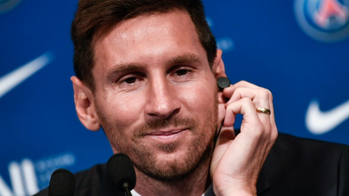 Lionel Messi speaks at a press conference during his unveiling at the French football club Paris Saint-Germain's Parc des Princes stadium in Paris on August 11, 2021.