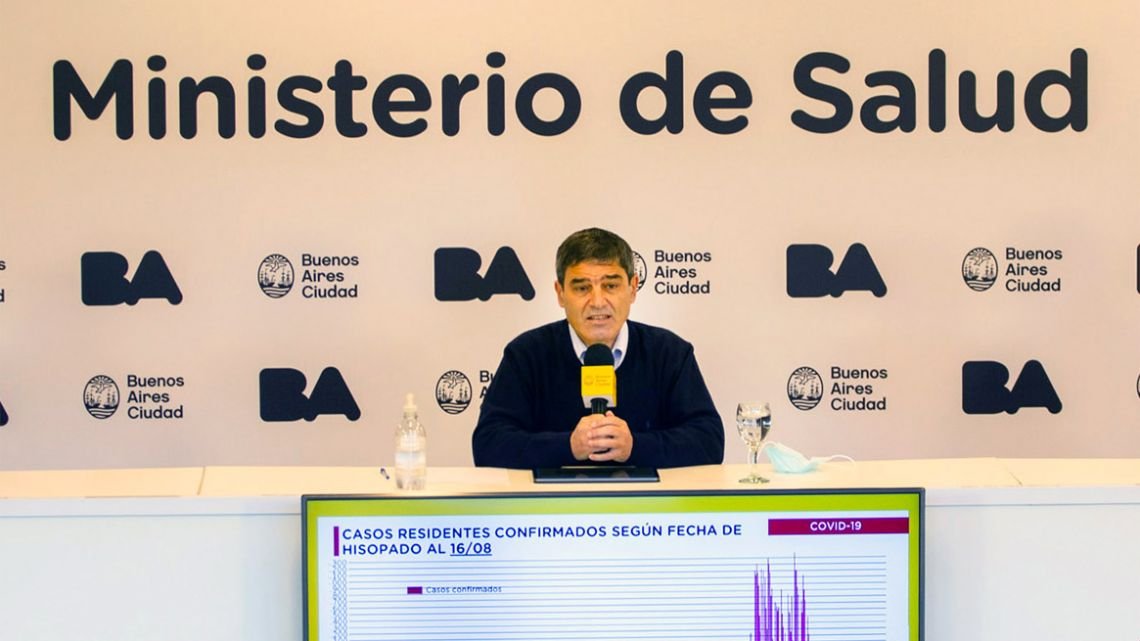 Buenos Aires City Health Minister Fernán Quiros (centre) leads a press conference.