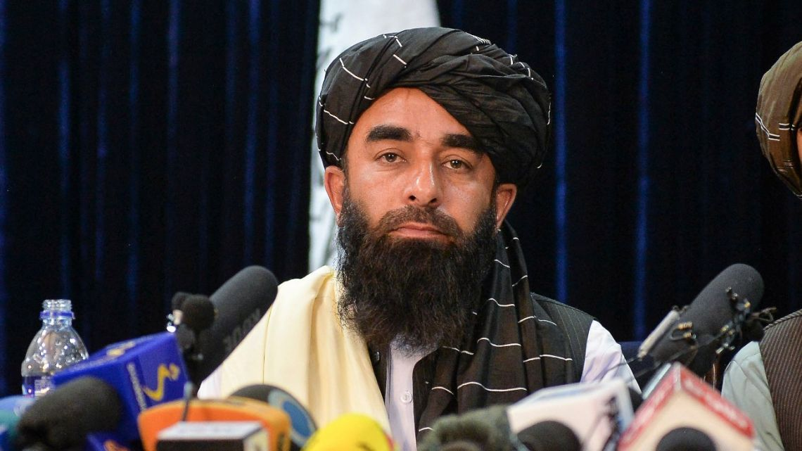 Taliban spokesperson Zabihullah Mujahid looks on as he addresses the first press conference in Kabul on August 17, 2021 following the Taliban stunning takeover of Afghanistan.