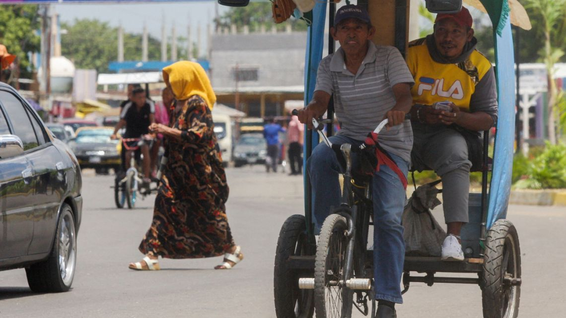 A man rides a traditional tricycle taxi in Maracaibo, Zulia State, Venezuela, on July 29, 2021.