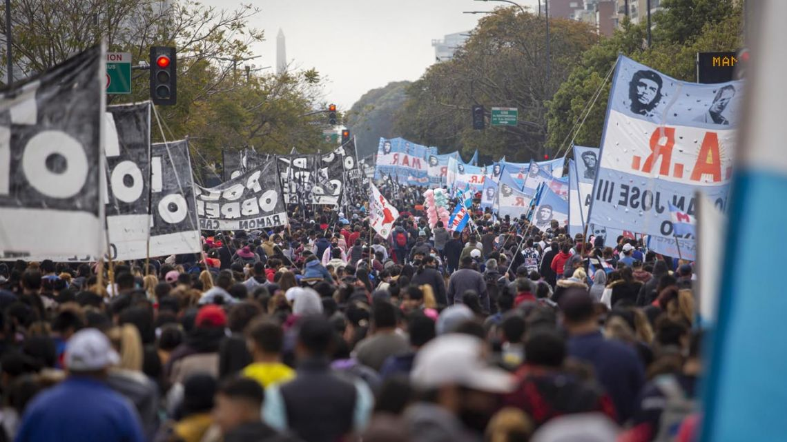 Protesters rally to demand improved aid during a protest on Avenida 9 de Julio.