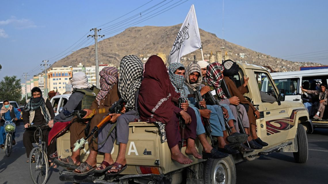 Taliban fighters in a vehicle patrol the streets of Kabul on August 23, 2021, as in the capital, the Taliban have enforced some sense of calm in a city long marred by violent crime, with their armed forces patrolling the streets and manning checkpoints.