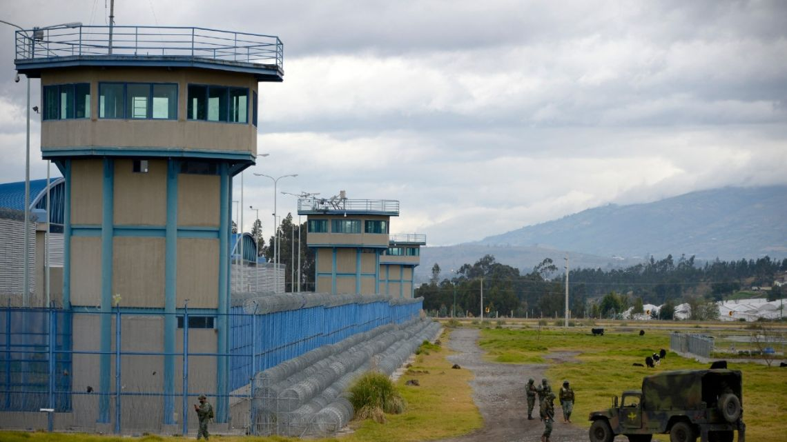 In this file photo taken on July 22, 2021 soldiers stand guard outside the Sierra Centro Norte prison in Latacunga, Ecuador, after a riot which left 21 dead occurred.