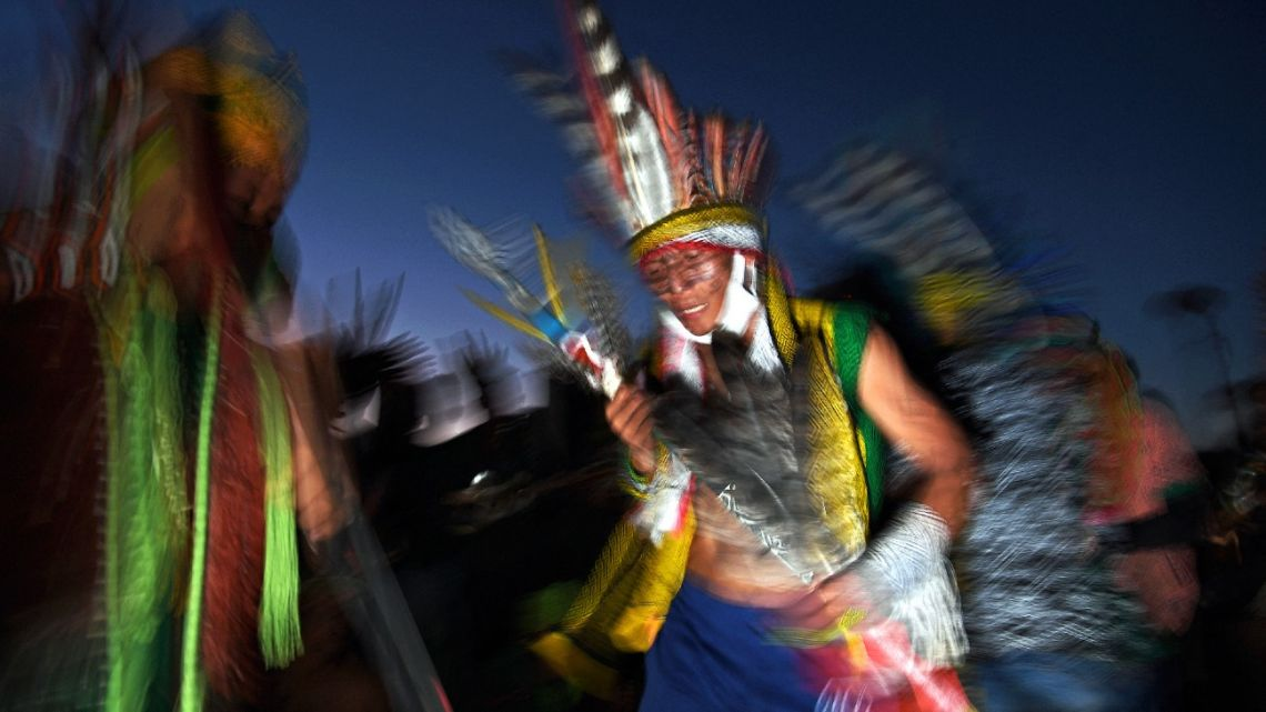 A member of the Huni Kuin tribe takes part in a ceremony at a protest camp in Brasilia, on August 22, 2021.