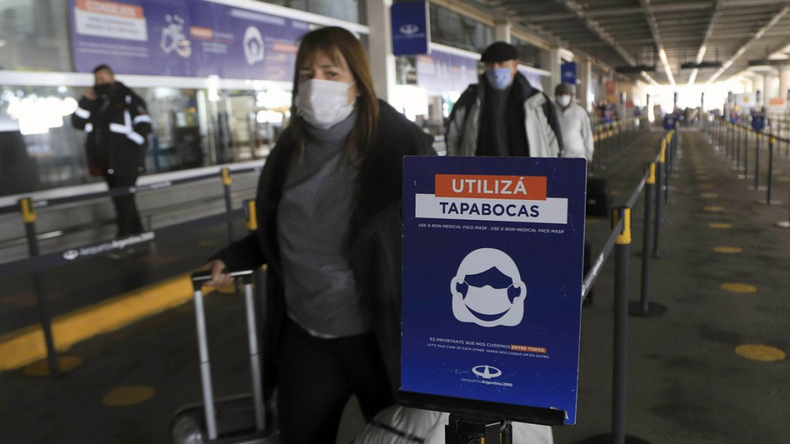 Passengers pass through Ezeiza international airport.