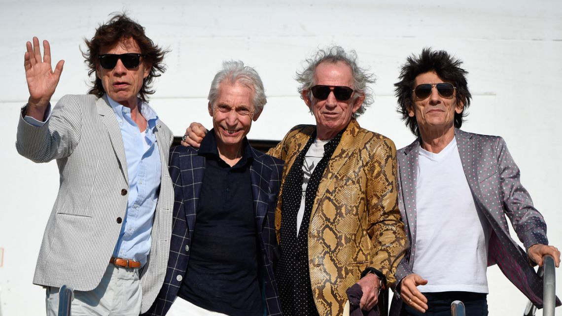 In this file photo taken on February 15, 2016, The Rolling Stones (left to right) – Mick Jagger, Charlie Watts, Keith Richards and Ron Wood – are pictured upon landing in Montevideo. Charlie Watts, drummer with legendary British rock'n'roll band the Rolling Stones, died on August 24, 2021 aged 80, according to a statement from his publicist.