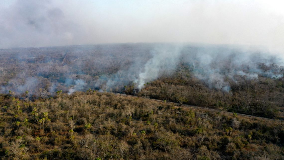 Aerial view of a wildfire near San Matías, Santa Cruz department, Bolivia, on August 20, 2021. The San Matías Natural Area of Integrated Management area (ANMI) is one of seven protected natural areas currently experiencing wildfires within Bolivia's Santa Cruz department, where more than 402,000 hectares of land have been burned since the beginning of 2021.