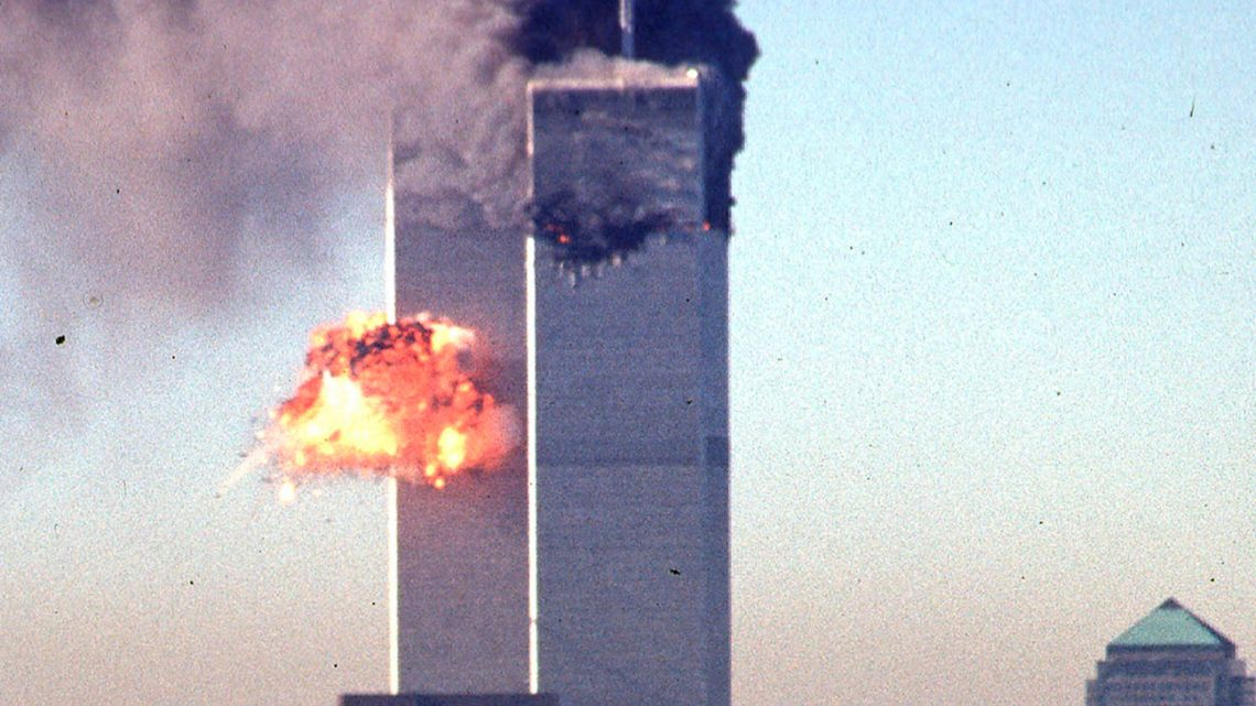 In this file photo smoke and flames erupt from the twin towers of the World Trade Center after commercial aircraft were deliberately crashed into the buildings in lower Manhattan, New York on September 11, 2001.