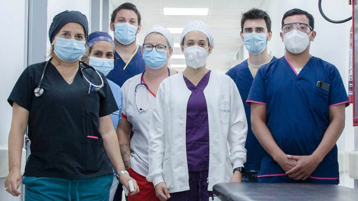 Healthcare professionals pose for a photograph at a hospital in Buenos Aires Province.