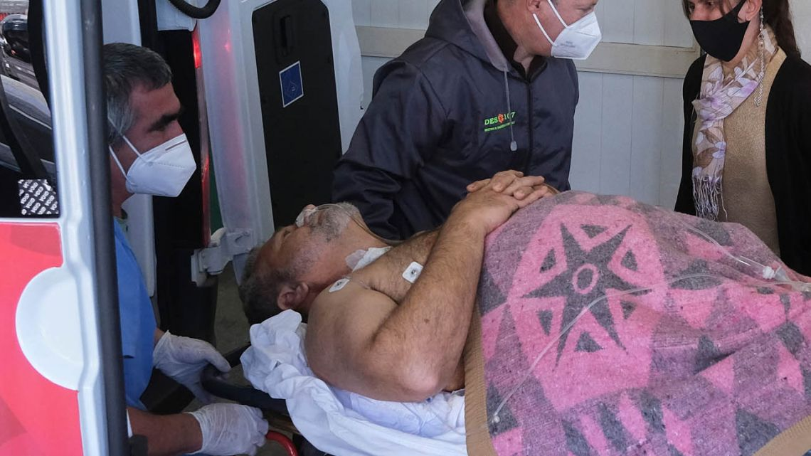 Peronist deputy Miguel Arias is transferred to hospital after the shooting.