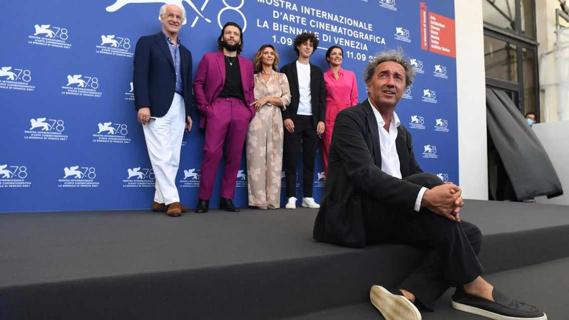 """Italian director Paolo Sorrentino (front right) and (from left, behind) Italian actor Toni Servillo, Italian actor Marlon Joubert, Italian actress Teresa Saponangelo, Italian actor Filippo Scotti and Italian actress Luisa Ranieri attend a photocall for the film """"E stata La Mano di Dio"""" (THe Hand of God) presented in competition during the 78th Venice Film Festival, on September 2, 2021 at Venice Lido."""