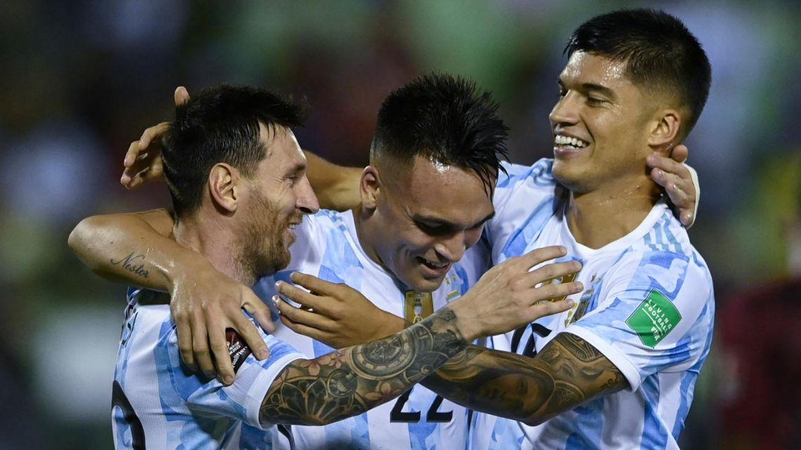 Argentina's Joaquín Correa (right) celebrates with teammates Lionel Messi (left) and Lautaro Martínez after scoring against Venezuela during their South American qualification football match for the FIFA World Cup Qatar 2022 at the UCV Olympic Stadium in Caracas on September 2, 2021.