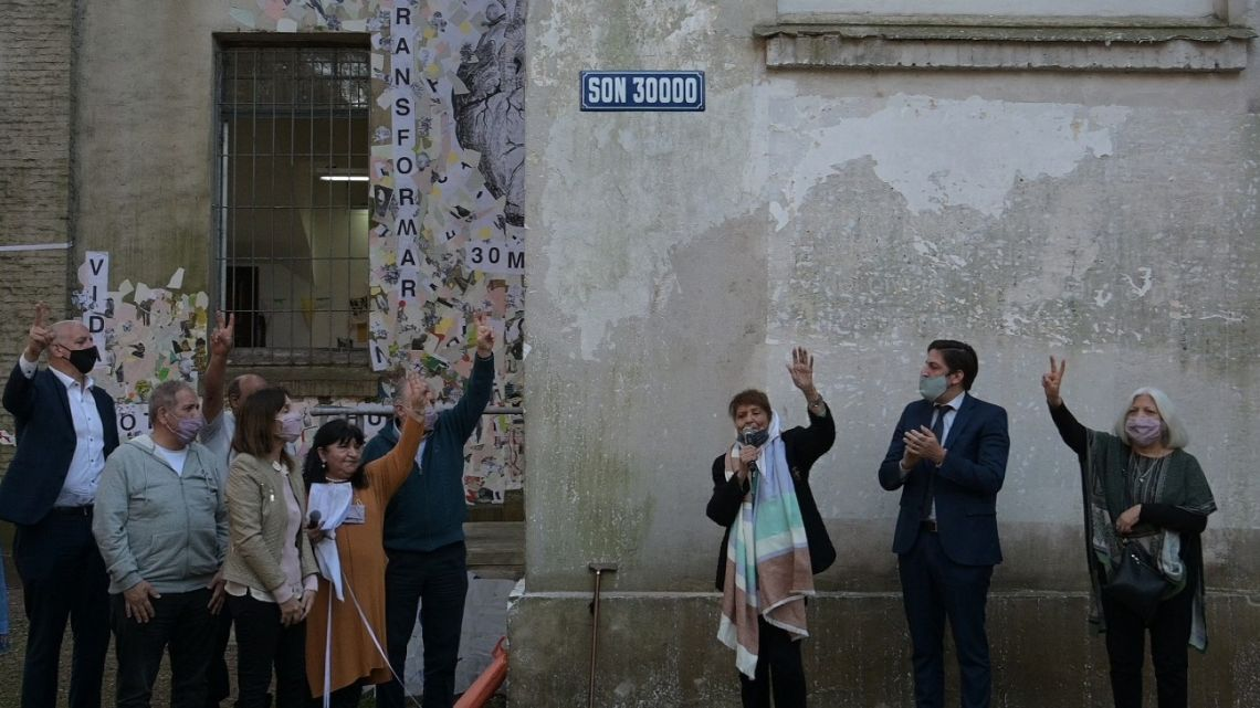Taty Almeida, member of Madres de Plaza de Mayo-Linea Fundadora, unveils the new road sign at the former ESMA Navy Mechanics School (ESMA) which was used as a torture centre during the last military dictatorship in Argentina (1976-1983), next to Argentina's Education Minister Nicolás Trotta (second from right) and Human Rights Secretary Horacio Pietragalla Corti (left) in commemoration of the International Day of the Victims of Enforced Disappearance in Buenos Aires on August 30, 2021.