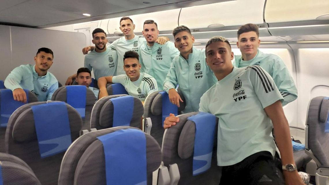 Members of the Argentina national team squad take a photograph onboard their plane back to Ezeiza International Airport, after departing Brazil following the suspension of their match.