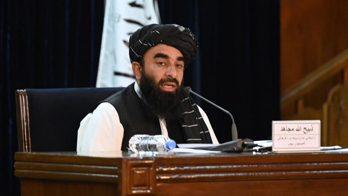 Taliban spokesman Zabihullah Mujahid addresses a press conference in Kabul on September 7, 2021. The Taliban on September 7 announced UN-sanctioned Taliban veteran Mullah Mohammad Hassan Akhund as the leader of their new government, while giving key positions to some of the movement's top officials.