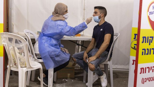 Covid-19 Testing and Booster Vaccinations as Israeli Cases Rise