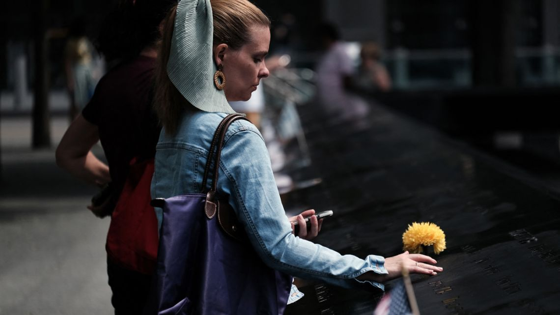 A woman mourns a relative at the September 11 Memorial at Ground Zero on August 31, 2021 in New York City.