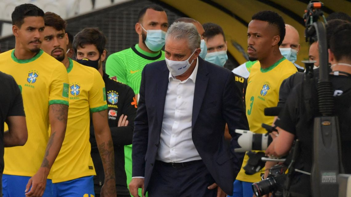 In this file photo taken on September 5, 2021, Brazil's coach Tite (centre) is seen after employees of the National Health Surveillance Agency (Anvisa) entered to the field during the South American qualification football match for the FIFA World Cup Qatar 2022 between Brazil and Argentina at the Neo Quimica Arena, also known as Corinthians Arena, in São Paulo, Brazil.