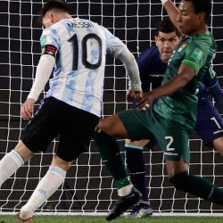 Images from Argentina's clash against Bolivia, in which Lionel Messi scored a hat-trick. After the match, the players celebrated their Copa América win with fans, in the first match played before spectators in Argentina since March 2020.