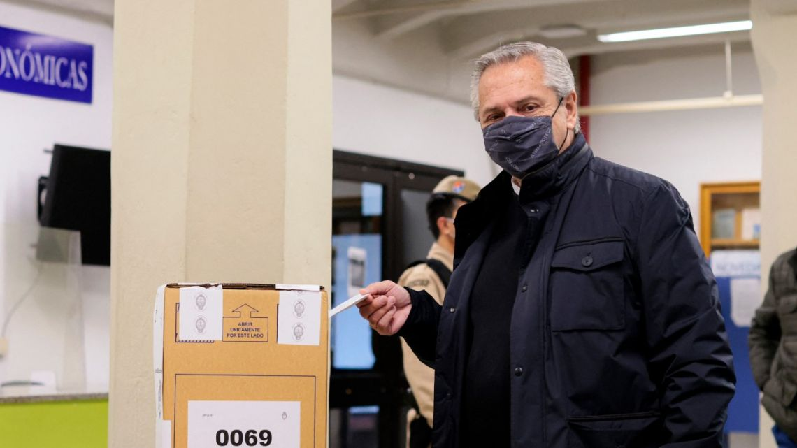 President Alberto Fernandez casts his vote during the PASO primary legislative elections, in Buenos Aires City on September 12, 2021.