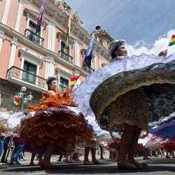 Bailarines de morenada bailan en la Plaza de Armas durante las celebraciones de la Fiesta Nacional de la Morenada en La Paz. | Foto:Aizar Raldes / AFP