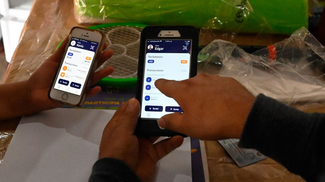 People use the Salvadoran government's electronic wallet Chivo, after bitcoins were put into circulation throughout the country as legal currency, in Sensuntepeque, El Salvador, on September 9, 2021. The Salvadoran government created the electronic wallet Chivo app so that Salvadorans abroad can send remittances to their relatives without paying transfer agency fees.