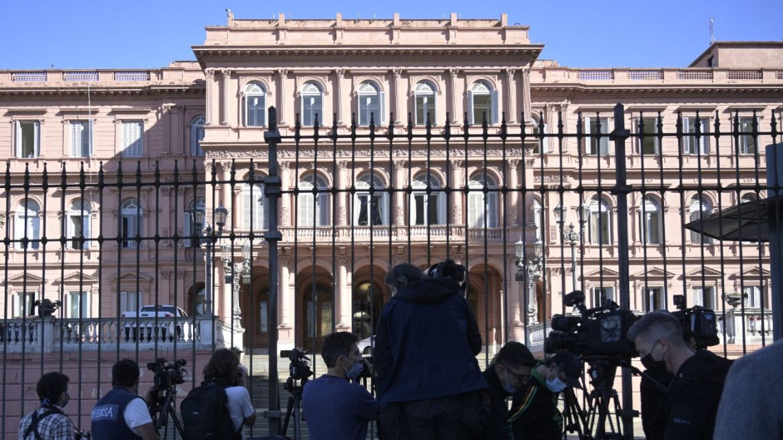 Cameramen and photojournalists stand guard outside the Casa Rosada government palace in Buenos Aires on September 16, 2021.