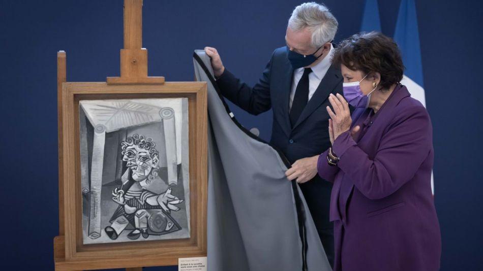 """Ministro de Economía francés y la obra de Picasso """"Niño con piruleta sentado debajo de una silla"""""""