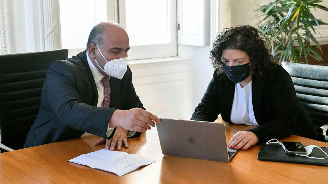 Handout photo released by Argentina's Chief Cabinet press office shows Juan Manzur (left) and Health Minister Carla Vizzotti during a meeting at the Casa Rosada in Buenos Aires on September 21, 2021.