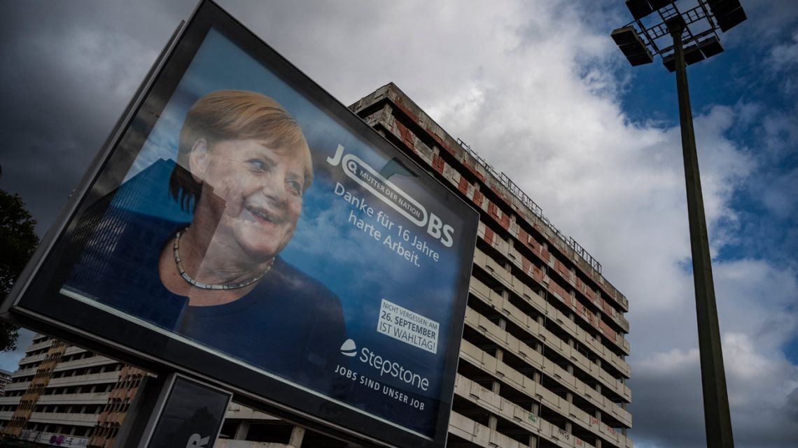"""An ad for German online job board StepStone features a portrait of German Chancellor Angela Merkel and reads: """"Mother of the Nation, Thank you for 16 years of hard work"""" in Berlin on September 22, 2021, ahead of parliamentary elections on September 26."""