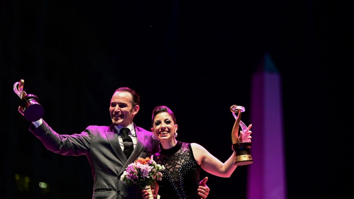 Argentina's Bárbara Ferreira (right) and Agustín Agnez (left) celebrate after winning the Tango Salon final competition in the framework of the Tango Dance World Championship in Buenos Aires on September 25, 2021.