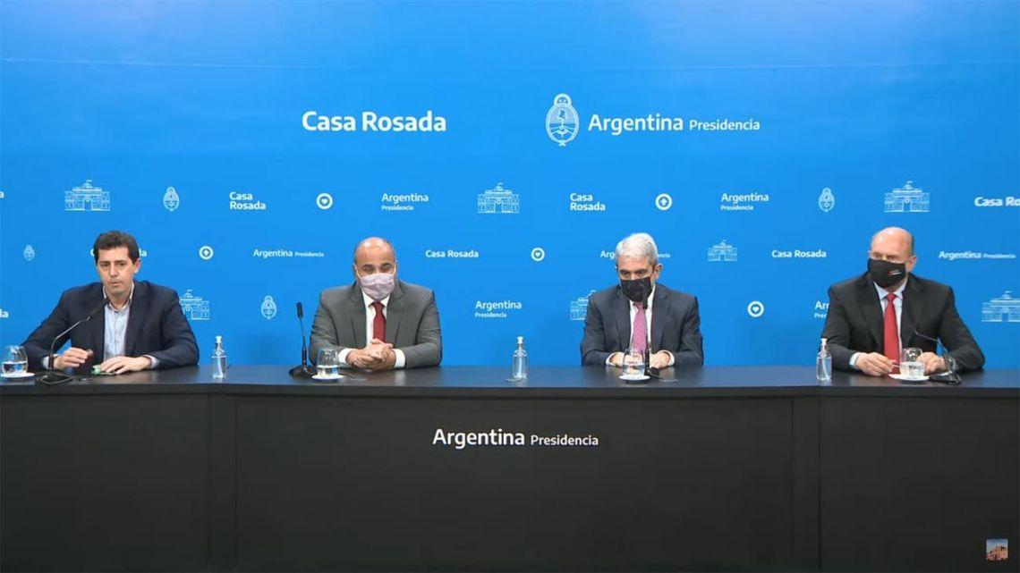 Interior Minister Eduardo 'Wado' de Pedro, Cabinet Chief Juan Manzur, Security Minister Aníbal Fernández and Santa Fe Province Governor Omar Perotti, pictured at a press conference at the Casa Rosada.