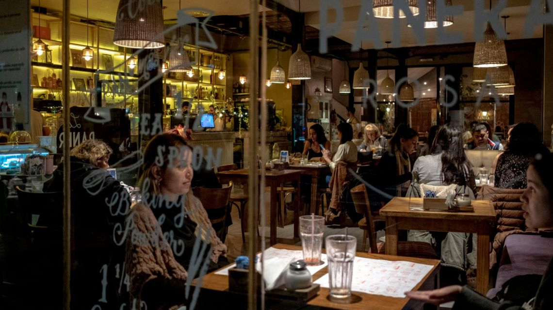 Customers dine at a restaurant in the Palermo neighbourhood as mask and capacity restrictions are lifted.