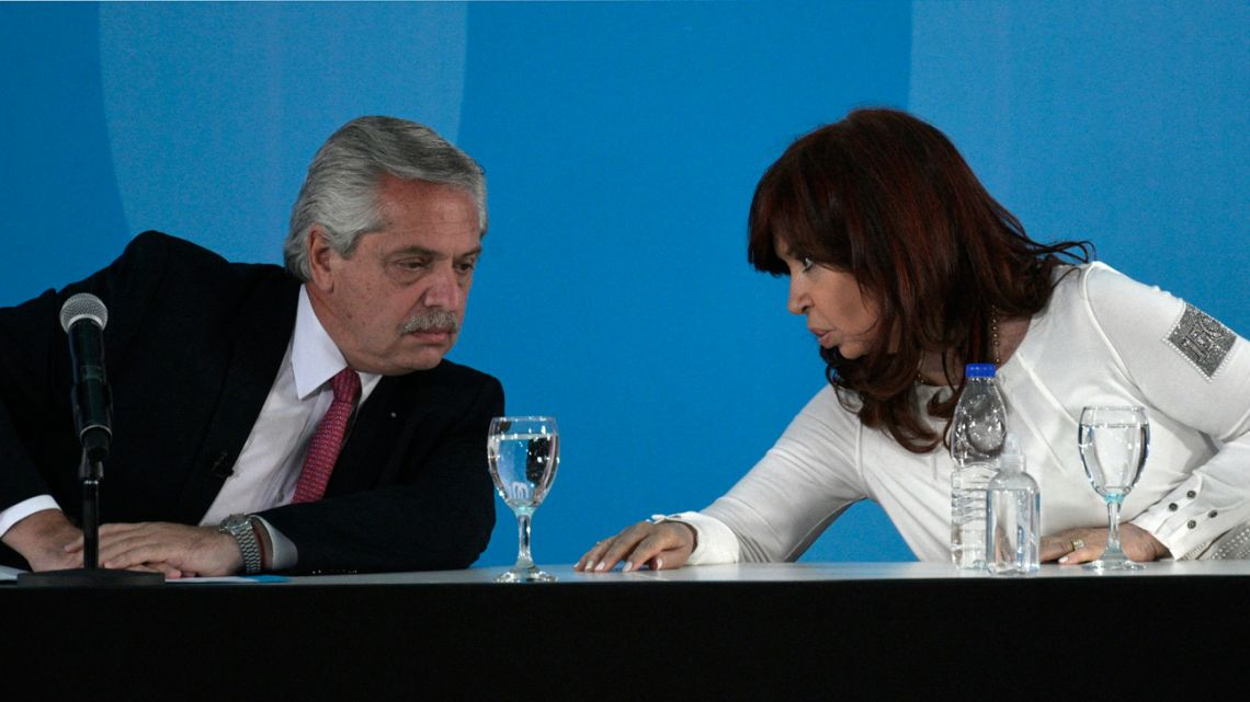 President Alberto Fernández (left) and Vice-President Cristina Fernández de Kirchner talk during the presentation of a bill to boost agroindustrial development at the Casa Rosada in Buenos Aires on September 30, 2021.