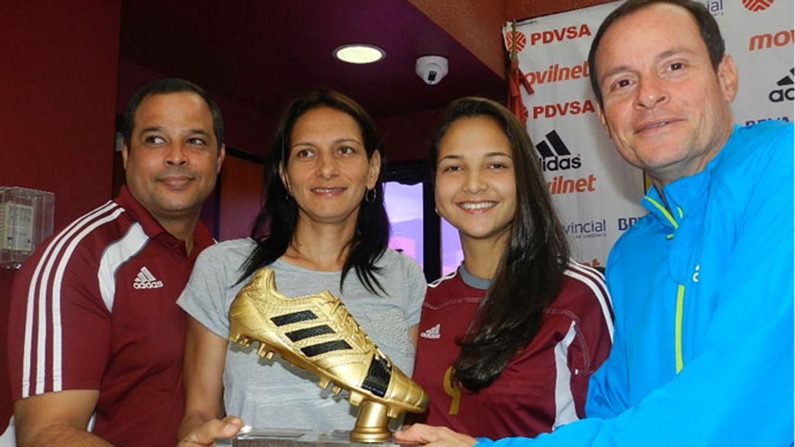 In this 2014 file photo, coach Kenneth Zseremeta (right) awards the under-17 Women's World Cup golden boot to Venezuelan players Deyna Castellanos and Gabriela García.