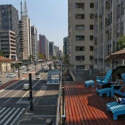 A man works at the terrace of a coworking space over Paulista Avenue, in São Paulo, Brazil, on September 27, 2021